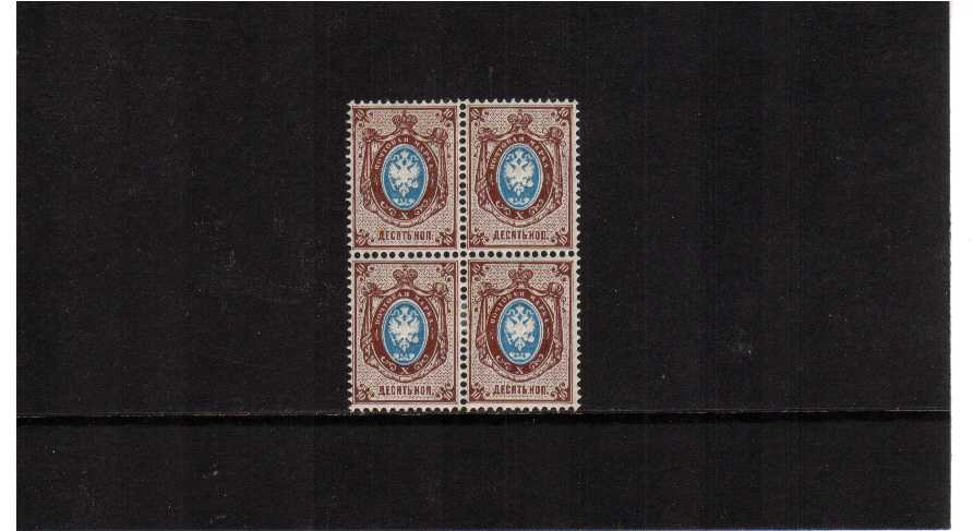 10K blue and reddish brown in a block of four, one stamp has a dealers mark on the gum but one stamp is superb unmounted mint. Scarce block.